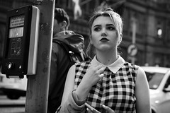 The Wait (Cliff.j) Tags: street city portrait urban girl necklace holding waiting edinburgh crossing phone looking dress princess bokeh candid sony watching gingham lipstick a7 daydreaming
