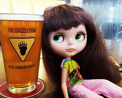 Anouk and her pint of Grizzly Paw Grumpy Bear Honey Wheat Ale