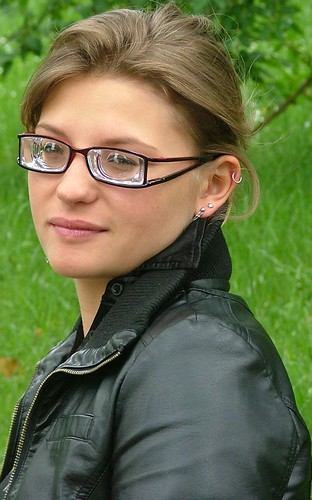 7daac44df82c Cute brunette girl wearing split arm glasses with super strong and thick -15  lenses