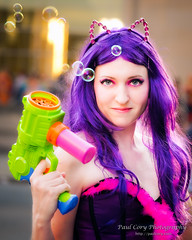 The Deadly Bubble Gun (Paul Cory) Tags: lighting camera city sunset portrait people woman season lens costume spring unitedstates availablelight northcarolina naturallight bubbles raleigh cosplayer onlocation sciencefictionconvention animazement wakecounty postprocessing fujicamera timeofday downtownraleigh niksoftware fujilens cropratio colorefexpro4 fujifilmxt1 yachancosplay fujifilmxf50140mmf28rlmoiswr fromcamerajpeg animazement2015