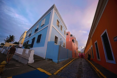 Old San Juan (Mark Liddell) Tags: road street old pink blue trees sunset sky orange sun building cars window yellow architecture clouds buildings puerto daylight rainbow san day angle juan oldsanjuan puertorico balcony colonial wide peach rico cobblestones cobble tropical caribbean colourful roads avenue ultra height settlement 14mm