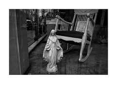 Statue of the Virgin Mary in curio shop window (Richard C. Johnson: AKA fishwrapcomix) Tags: fujixpro1 18mm paxamericanus endofempire bw shopwindow blackwhite monochrome thegreatrecession economicdownturn duluth minnesota civisromanussum decline decay midwest window reflections lookinin sunsetsinthewest sunrisesintheeast sacred