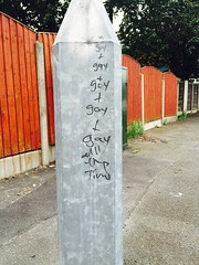 Manchester Graffiti No 16 (mary01985) Tags: pavement fencepost fence manchester felttip markerpen everyday words insult abuse profundity gay streetlight metal light street graffiti lamppost