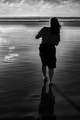 Chasing the Sun (Ric George) Tags: beach arty sun chasing light sand newzealand doubtlessbay footprint wife sea waves silhouette shadow beauty travel walking back woman etherial natural portrait nature scenery people photo year