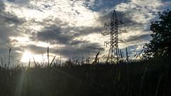 Against (pozzhe) Tags: grass sun powerline cloud sky kazan pylon pillar wires