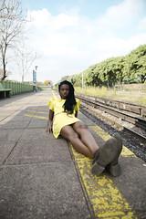 (lapoetto) Tags: street portrait sky woman tren outdoors legs blackwoman yellowdress frenchwoman