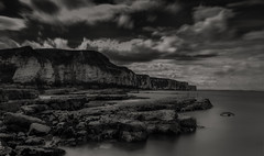 Ghost on the rocks B & W (simoncrabtree110) Tags: longexposure sea blackandwhite bw cloud white black sepia clouds bay nikon rocks long exposure yorkshire north sigma east landing riding filter lee 1020mm bridlington thornwickbay thornwick flamborough 10stop d7100