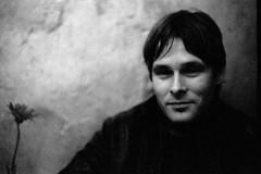 a flower and a friend (asketoner) Tags: winter portrait man blur flower berlin face wall bar night crispy