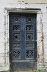 Old metal mausoleum door, dated 1834 (Monceau) Tags: prelachaise metal mausoleum door symbols 1834