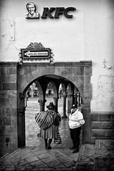 Clash of Cultures (Dave_Davies) Tags: street city food woman peru mono costume candid cusco traditional culture fast police clash kfc officer