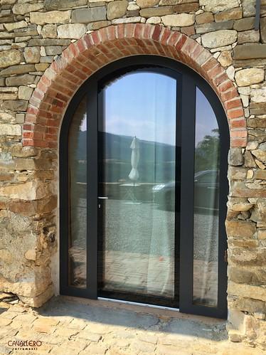 Portafinestra DUO Legno-Alluminio ad arco con vetro strutturale