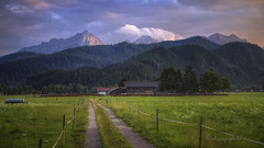 umlaut of light (cherryspicks (intermittently on/off)) Tags: alps bavaria germany farm field sunset glow light landscape mountain grassland grass foothill outdoor rural clouds weather path