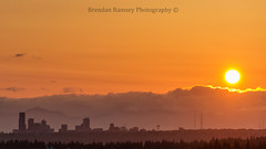 Hump Day sunset from Bellevue to the backside of Seattle (Brendinni) Tags: seattle trees sunset orange sun mountains skyline clouds washington bellevue