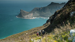 Day Hike (AndreDiener) Tags: hiking hikinggroup slope path sentinel harbour mountaingrass sea blue grass people