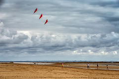 The Kite Flyers (Hugh Rawson) Tags: kite beach normandy cloud sky stgermainsuray red france clouds