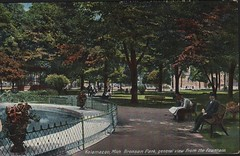 Front: Kalamazoo, Mich. Bronson Park General View from the Fountain (kplcommons) Tags: kalamazoopubliclibrary bronson park downtown fountain bench people outside fence postcard