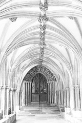 Cloisters (2) (Michelle Tuttle) Tags: norfolk norwich norwichcathedral cloisters architecture building archway arch door roof