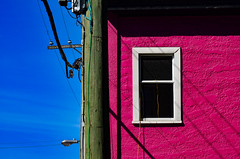 Magnificent magenta (James_D_Images) Tags: magenta pink building paint white window trim utilitypole utilitylines power extensioncord blue sky shadow vancouver britishcolumbia