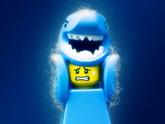 Shark guy in water (jezbags) Tags: lego macrolego shark guy minifigure blue yellow water liquid canon60d canon 60d 100mm macro macrophotography macrodreams scared depths sea bubbles