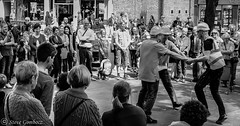 Ring a ring a roses........ (steve.gombocz) Tags: york street olympus people audience entertainment bw bwphotos blackandwhite blacknwhite flickrbw bwflickr flickrblackwhitephotos blackwhitephotos streetbw bwstreet streetentertainment dancing noiretblanc schwartzundweiss negroyblanco zwartwit neruebianco sortoghvid mustavalkoinen svarthvitt svartoghvitt svartochvitt czarnyibiaty noirblanc schwartzweiss negroblanco nerobianco micro43rduk olympuszuikodigitalclub olympusbw olympusdigitalcamerausers olympusem5mark2 olympusm25mmf18 olympususers olympusmzuiko25mmf18lens smiling laughing blackwhite whiteblack bwstreetphotos greyscale monochrome streetphotography
