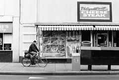 Nomadic Cyclist (TnOlyShooter) Tags: streetphotography nashville tennessee cyclist bike homeless phillyman cheesesteak nomad olympusom1 olympusomzuiko50mmf18 findlab ilfordhp5plus400 film analog