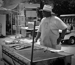 Rib Man (tim.perdue) Tags: jazz rib fest festival summer 2016 street scioto mile downtown columbus ohio urban city candid man person figure grill ribs burner hat sunglasses tongs apron black white bw monochrome cowboy jazzfest