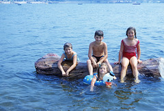 The beach crew on the log that kept coming back every summer. Left to right: My girlfriend's sister, me, my sister in an inflatable duckie, my girlfriend in a red bathing suit. A little bit of the Villa Rosa mansion at top. Milford Connecticut. July 1967 (wavz13) Tags: longislandsound connecticutshoreline beach swimming oldphotographs oldphotos 1960sphotographs 1960sphotos oldphotography 1960sphotography vintagesnapshots oldsnapshots vintagephotographs vintagephotos vintagephotography filmphotos filmphotography vintagemilford oldmilford 1960smilford vintagewoodmont oldwoodmont 1960swoodmont connecticutphotographs connecticutphotos oldconnecticutphotography oldconnecticutphotos oldconnecticut vintageconnecticut connecticutphotography vintagenewengland oldnewengland 1960snewengland vintagenewenglandphotography oldnewenglandphotography vintagenewenglandphotos oldnewenglandphotos kodachrome oldslides vintageslides familyslides vintagekodachrome oldkodachrome oldfamilyslides oldfamilyphotos vintagefamilyphotos oldfamilyphotography vintagefamilyphotography vintagekids vintagechildren vintageteens vintageteenagers teenmemories teenagememories kids summer summermemories vintagebathingsuits oldbathingsuits floaties shoreline driftwood donaldduck disneyana disneycollectables disneycollectibles vintagedisney