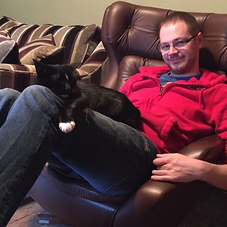Two happy people! #badger #cat #feline #fiance #boyfriend #sofa #chair #sleep #black #white #paws #duresta #parker #knoll #Hollister #aberdeen #gayuk #jeans #smile