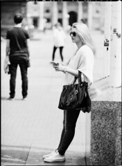 On the Phone in Zagreb V (holtelars) Tags: pentax pentax645 645 645n 6x45 smcpentaxfa 200mm f40 120 mediumformat film analog analogue filmforever filmphotography larsholte homeprocessing d76 blackandwhite classicblackwhite foma fomapan monochrome zagreb croatia girl mobile phone cellphone street hrvatska josipajelacica atl1500 autolab bw jobo streetphotography fomapan100classic fomapan100
