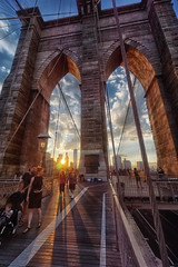 Sunset promenade (marko.erman) Tags: city travel bridge family sunset people sun newyork silhouette architecture brooklyn walking downtown arch shadows unitedstates manhattan sony wideangle cables promenade contrejour uwa