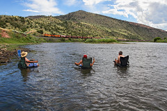 Soakin in the river (Moffat Road) Tags: railroad people mountains train river mt relaxing canyon bnsf lombard mrl missouririver toston graintrain montanaraillink lombardcanyon mrlsecondsubdivision mrl2ndsub