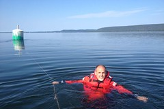 buoy (Jonathan Riverwalker) Tags: buoy coast guard exercise floater suit