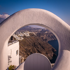 Through the arch (Kelly's Eye Pics) Tags: hole entrance doorway arch imerovigli santorini fira thira greece gap cliff volcano pentaxk5ii 1685mm white blue sea opening rocks edge steep