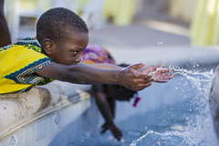 IMG_0366 (nollysoul) Tags: boy wet water fountain highshutter splashingwater highframerate