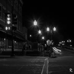 192/366 - Mixed Messages at 3rd and Main (sdgiere) Tags: longexposure blackandwhite traffic iowa lensflare intersection dubuque trafficsignal afterdark