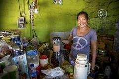 "A local woman shows off her restaurant or ""warung"". (wrightontheroad) Tags: local turtleisland localrestaurant warung serangan bali indonesia"