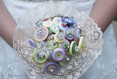 Bouquet (Kay-Dee) Tags: bouquet button buttons wedding weddingphotography bride bridal bridalphotography cute handmade handmadebouquet lace white colourful colorful colours colors pretty decoration gems sparkly sparkle unusual quirky buttonbouquet craft crafts detail weddingdetail