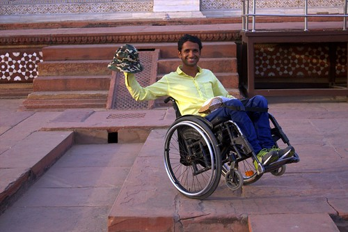 One of our traveller on wheelchair enjoying the tour of Taj Mahal.