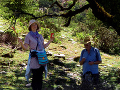 Happy with Peter in the shade (angeloska) Tags: ikaria hikingtrails opsikarias aegean greece signage    smile atheras girl  april