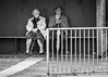 Patiently waiting (BenChapmanphoto) Tags: old uk blackandwhite bw woman man slr love smile canon fence bench rebel couple sitting serious may streetphotography sigma lincolnshire busstop aged spalding 2015 canon450d moultonchapel rebelxsi sigma70200mm128exdgoshsm