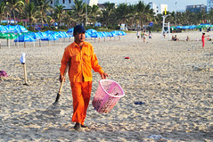 Keeping it clean (Roving I) Tags: sunrise dawn workers sand cleaners vietnam beaches barefeet uniforms danang rakes plasticbaskets