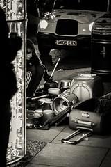 London Nov 2015 (7) 004 - Playing the pans on Oxford Street (Mark Schofield @ JB Schofield) Tags: park christmas street city winter england white black london monochrome canon artist fairground carousel hyde oxford entertainer rides nightlife busker wonderland stalls 5dmk3