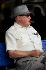 2016-07-15 (20) Laurel Park - cigar smoking race fan (JLeeFleenor) Tags: photos photography md maryland marylandhorseracing man people fans cigars cigarsmoker smoker outside outdoors