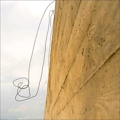 somewhat independant (me*voil) Tags: wall concrete diagonal wire curve knot abstract