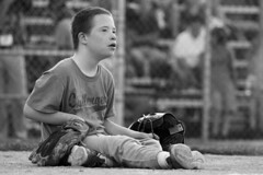 Up To The Challenge (Kyle William Russell) Tags: baseball diamond catcher boy young glove helmet rim lights daytime dirt portrait kid child sports athletic athlete