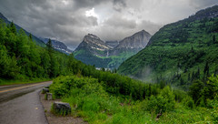Storm Clouds (Paul Domsten) Tags: glaciernationalpark goingtothesunroad clouds mountainside hill weather rain pentax montana trees road waterfall rokinon14mm28 glacier birdwomanfalls mtoberlin mtclements mtcannon
