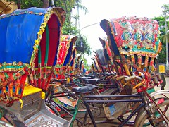 Rickshaws Waiting (karla.hovde) Tags: bangladesh asia travel dhaka city urban rickshaw ricksha bicycle vehicle vanishing point color bright repetition balanced symmetry symmetrical