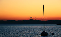 Sail (axelmeuwly) Tags: blue sunset orange mountain lake water canon landscape switzerland boat colorful sail montreux