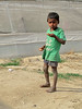 Boy Eating in Front of a Polyhouse (IFPRI) Tags: boy food india village child farm eat hunger malnourishment manoli sustain haryana stunted sonipat foodsecurity polyhouse ifpri agriculturaldevelpoment