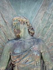 Verdigris angel - relief sculpture on a grave monument (Monceau) Tags: cimetireduprelachaise prelachaise verdigris angel turned head relief sculpture mausoleum door